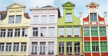 The narrow colorful facades of the old mansions in Patershol neighborhood of Ghent, Belgium.