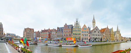 GHENT, BELGIUM - MAY 26, 2011: Panorama of the Graslei Quay, occupied with the picturesque stepped gable mansions and guild houses, numerous pleasure boats on the Leie River, on May 26 in Ghent. Editorial