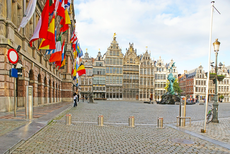 The dense row of the medieval guildhouses at the Great Market Square with the Brabo fountain on the foreground, Antwerp, Belgium. Stock Photo