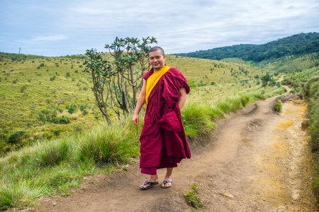 plains indian: HORTON PLAINS, SRI LANKA - NOVEMBER 30, 2016:  The monk walks in Horton Plains Park, on November 30 in Horton Plains. Editorial