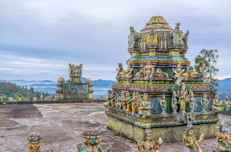 dome of hindu temple: The richly decorated dome of the Hindu Temple with the foggy mountains on the background, Hakgala, Sri Lanka.