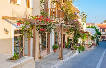 RETHYMNO, GREECE - The view on the street of the old town with small souvenir shops on it, on October 15 in Rethymno. Stock Photo
