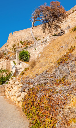 The slopes of the fortress hill in Rethymno are the best place to relax and have sunbathes in low season, Greece