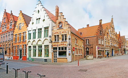 BRUGES, BELGIUM - MAY 26, 2011: The corner of Sint-Jakobsstraat street with magnificent medieval brick stepped gable mansions, serving as stores, cafes and hotels, on May 26 in Bruges.