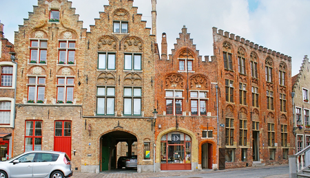 BRUGES, BELGIUM - MAY 26, 2011: The medieval stepped gables of mansions, located at Genthof, on May 26 in Bruges. Editorial