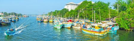 NEGOMBO, SRI LANKA - NOVEMBER 25, 2016: Panorama of the fishing port, stretching along the shores of lagoon to the ocean, on November 25 in Negombo.