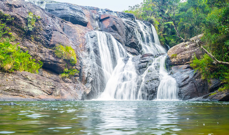 plains indian: The Bakers Falls is not a huge but one of the most beautiful waterfalls in Sri Lanka Stock Photo