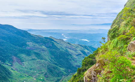 The morning view on the mountain region of Sri Lanka from the most famous viewpiont of the island - The Worlds End. Stock Photo