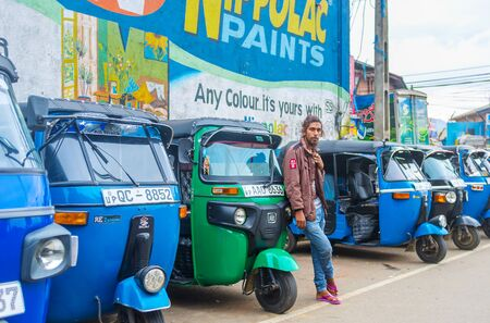 HAPUTALE, SRI LANKA - NOVEMBER 30, 2016: The tuk-tuk driver waits for clients at the taxi stand, on November 30 in Haputale