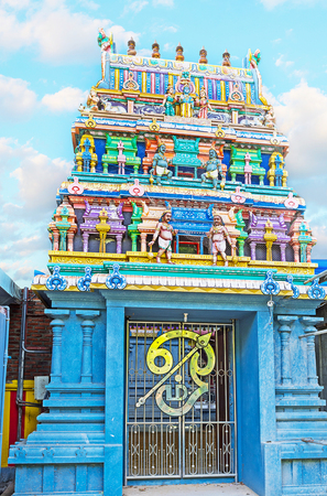 The richly decorated gates to Murugan Temple in Chilaw, Sri Lanka.