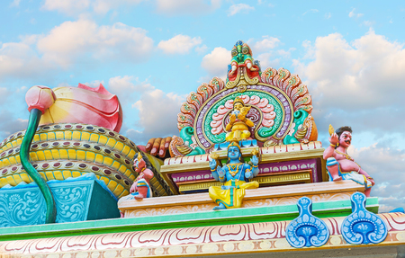 The colorful decorative elements of Murugan Temple, the sculptures of Hindu Gods among the relief patterns and lotus flowers, Chilaw, Sri Lanka. Stock Photo