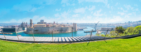Panorama of historic district with the view on old port and Fort Saint-Jean from the Park of Emile Duclaux, Marseille, France. Stock Photo