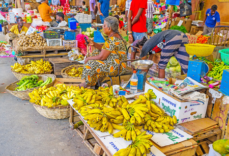 COLOMBO, SRI LANKA - DECEMBER 6, 2016: The bunches of yellow bananas on counter and in boxes at Fose Market in Pettah, on December 6 in Colombo. Editorial