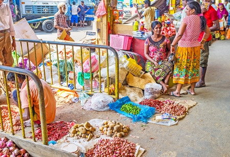COLOMBO, SRI LANKA - DECEMBER 6, 2016: The side exits from Fose Market in Pettah occupied with small traders, offering vegetables for food and planting from the floor, on December 6 in Colombo.