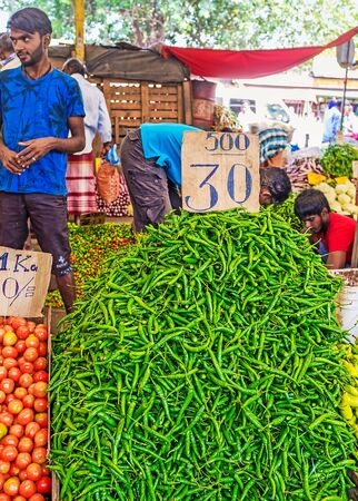 COLOMBO, SRI LANKA - DECEMBER 6, 2016: The large heap of green pepper at the vegetable stall of Fose Market in Pettah, on December 6 in Colombo.
