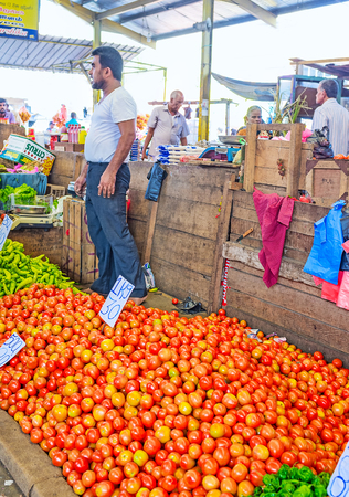 COLOMBO, SRI LANKA - DECEMBER 6, 2016: The heap of red tomatos at Fose agricultural market, on December 6 in Colombo.