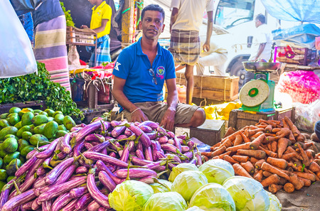 COLOMBO, SRI LANKA - DECEMBER 6, 2016: The heaps of fresh papaya, eggplant, cabbage and carrot at Fose agricultural market, on December 6 in Colombo.