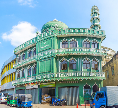 COLOMBO, SRI LANKA - DECEMBER 6, 2016: The bright green facade of Jumma Mosque (Al Masjid Al Dheeniyah), hidden in maze of streets of Pettah neighborhood, on December 6 in Colombo.