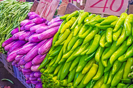The vegetable stall in Fose Market - heaps of bright green peppers and purple eggplants, Colombo, Sri Lanka.