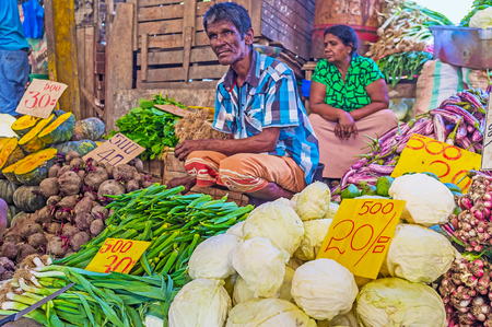 COLOMBO, SRI LANKA - DECEMBER 6, 2016: The farmers sell their vegetables and fruits in Fose (Federation of Self Employees) Market in Pettah, on December 6 in Colombo.