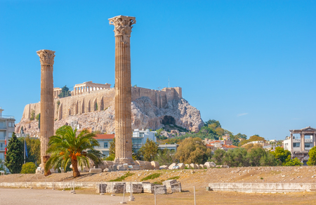 The Acropolis Hill with Parthenon on the top behind the carved stone columns of Olympian Zeus Temple, Athens, Greece