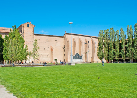 pace: PARMA, ITALY - APRIL 24, 2012: The green lawn on Pace Square in front of the Palace of Pilotta, the medieval complex and one of the main place of tourist and historic interest in city, on April 24 in Parma.