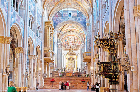 pilasters: PARMA, ITALY - APRIL 24, 2012: The prayer hall of Duomo (Cathedral) with splendid medieval frescoe, marble pilasters and carved decorations, on April 24 in Parma. Editorial