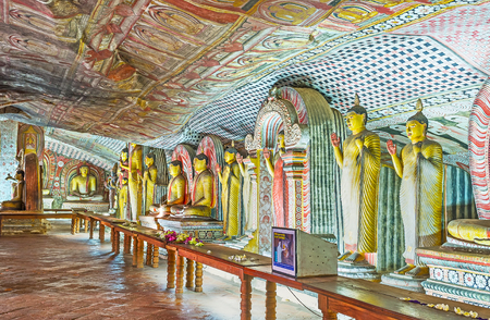 DAMBULLA, SRI LANKA - NOVEMBER 27, 2016: The Maharaja Lena Cave (Great Kings) od Dambulla Viharaya with numerous statues of Lord Buddha in different postures, on November 27 in Dambulla. Editorial