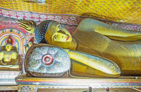 DAMBULLA, SRI LANKA - NOVEMBER 27, 2016: The sculpture of Reclining Lord Buddha in Maha Alut Viharaya (Great New Temple) of Dambulla Cave Monastery, on November 27 in Dambulla.