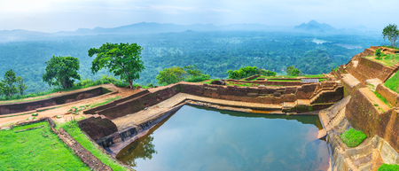 Panorama from the top of Sigiriya Rock with the ruins of upper palace and the cistern, cut into the rock, Sri Lanka. Stock Photo