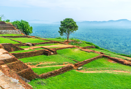 The Sigiriya Rock summit is occupied with the ancient ruins of the upper palace, Sri Lanka. Stock Photo
