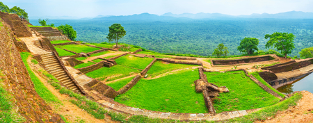 Panorama of Sigiriya upper palace with jungle forests and mountains on the background, Sri Lanka. Stock Photo