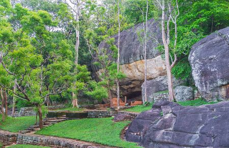 The numerous caves in Sigiriya rocks were used by Buddhist monks as shelters or temples, Sri Lanka. Stock Photo