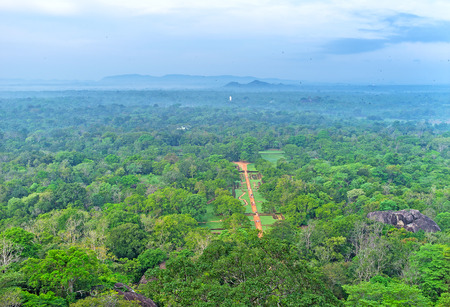 The foggy plain covered with lush jungles of Sigiriya Gardens and forests of Matale district, Sri Lanka. Stock Photo