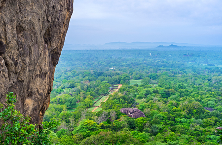 The Sigiriya Rock overlooks the plain with the Royal Gardens, Sri Lanka.