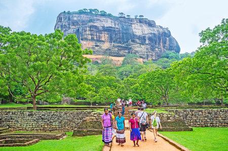 local 27: SIGIRIYA, SRI LANKA - NOVEMBER 27, 2016:  Sigiriya Fortress Complex is the famous destination among the local and foreigner tourists, visiting country, on November 27 in Sigiriya.
