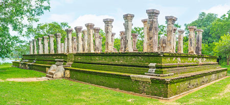 ancient lion: The rows of the carved stone pillars of the Kings Council Chamber at the archaeological site of Nissanka Malla Palace, Polonnaruwa, Sri Lanka.