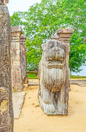 The Lions Throne among the ancient pillars in the Council Chamber of Nissanka Malla Palace, Polonnaruwa, Sri Lanka. Editorial