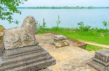 The lion at the entrance to the Kings Council Chamber of Nissanka Malla Palace with the Bendiwewa Lake on the background, Polonnaruwa, Sri Lanka.