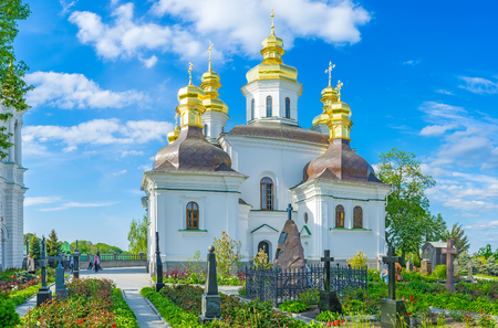 KIEV, UKRAINE - MAY 1, 2015:  The small cemetery with flower bed located behing the Church of the Nativity of the God, on May 1 in Kiev. Editöryel