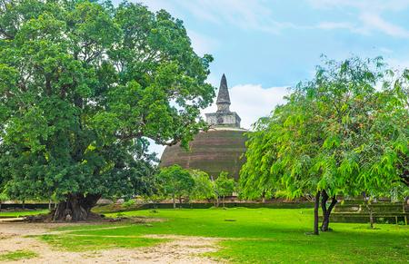 The old brick pagoda of Rankoth Vihara among the greenery of Polonnaruwa gardens, Sri Lanka.