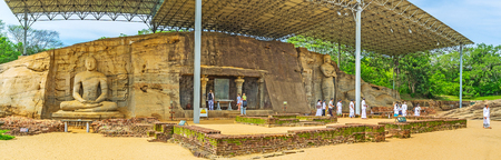vihara: POLONNARUWA, SRI LANKA - NOVEMBER 27, 2016: Panorama of Gal Viharaya with the relief granite statues of Lord Buddha, on November 27 in Polonnaruwa. Editorial