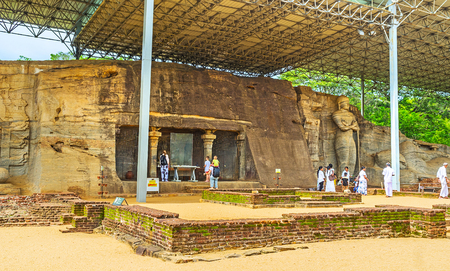 polonnaruwa: POLONNARUWA, SRI LANKA - NOVEMBER 27, 2016: Archaeological site of Gal Viharaya with the granite statues of Lord Buddha is the famous tourist and pilgrim place, on November 27 in Polonnaruwa. Editorial