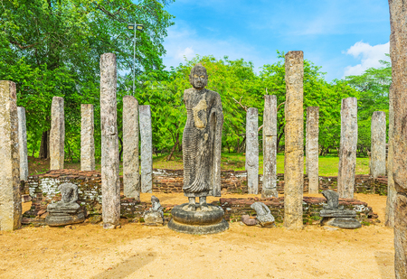 polonnaruwa: The Buddha statue among the ruins of the Atadage, built for the Tooth Relic in Dalada Maluwa, Polonnaruwa, Sri Lanka. Stock Photo