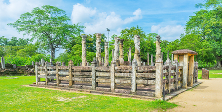 polonnaruwa: The stone ruins of Nissanka Latha Mandapaya with the curved columns, in shape of the lotus stork, Dalada Maluwa, Polonnaruwa, Sri Lanka.