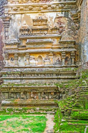 The preserved carved decors on the wall of the ruined Lankathilaka Temple, Alahana Pirivena, Polonnaruwa, Sri Lanka.