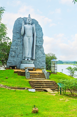 The statue of Lord Buddha at the bank of Giritale Lake, Sri Lanka. Stock Photo