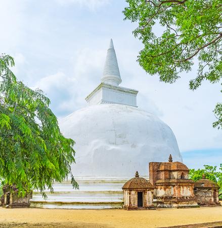 The Kiri Vihara (Rupavati Thupa) is the notable landmark, located at archaeological site of Alahana Pirivena, Polonnaruwa, Sri Lanka. Stock Photo