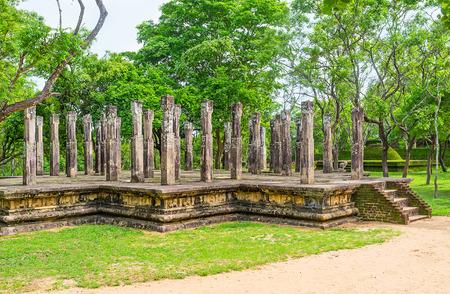 The ruins with numerous pillars next to the Lankathilaka Image House of Alahana Pirivena, Polonnaruwa, Sri Lanka. Stock Photo