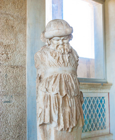 ATHENS, GREECE - OCTOBER 12, 2013: The sculpture of a mythology character of ancient period, located on Stoa of Attalos museum, on October 12 in Athens